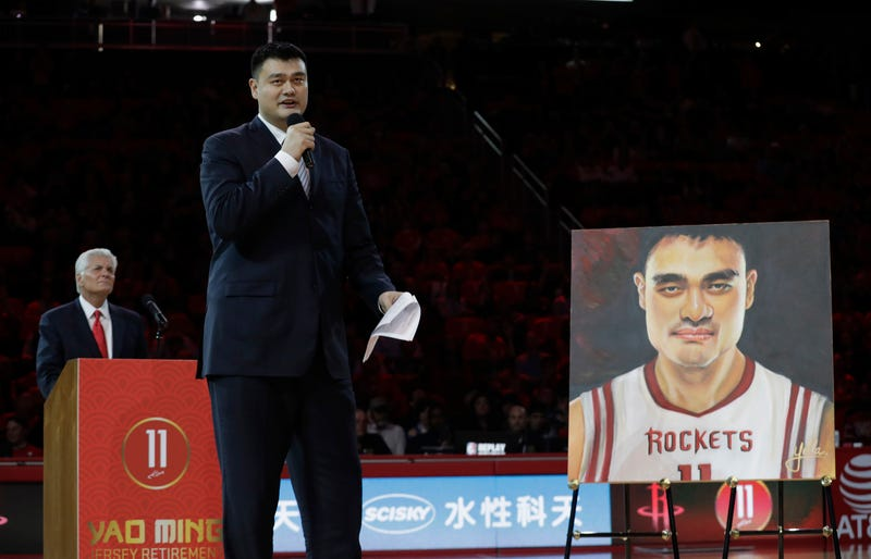 yao ming at his houston rockets jersey retirement ceremony