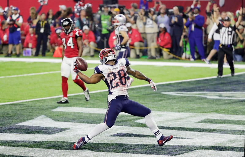 James White spikes the ball after scoring in Super Bowl LI