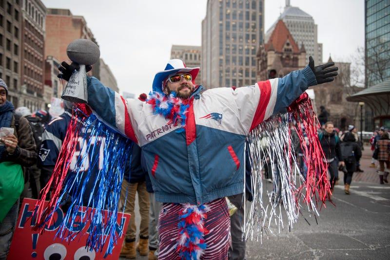 patriots fan celebrating in boston