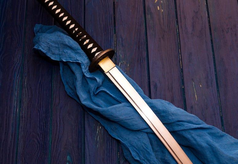 Samurai sword on wooden table