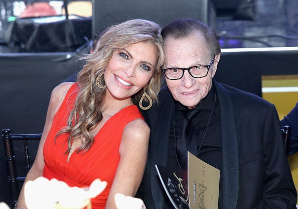 Shawn and Larry King pose for a photo.