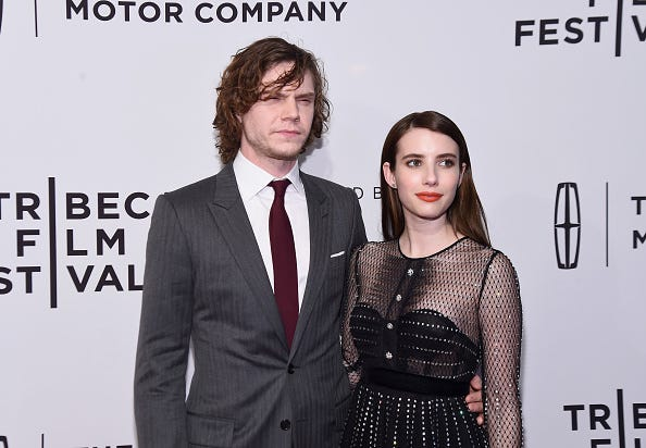 Emma Roberts and Evan Peters attend a red carpet together.