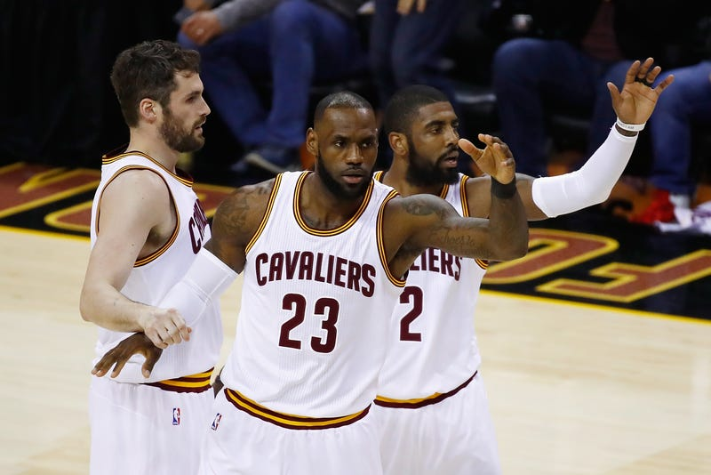 Kevin Love, LeBron James and Kyrie Irving