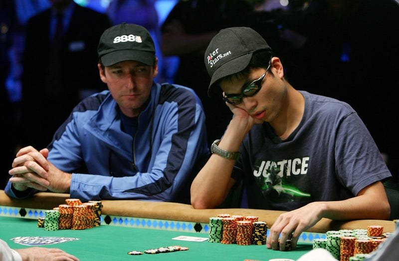 Rhett Butler (L) of Maryland watches Doug Kim of New York place a bet during the World Series of Poker no-limit Texas Hold 'em main event at the Rio Hotel & Casino August 8, 2006 in Las Vegas, Nevada.