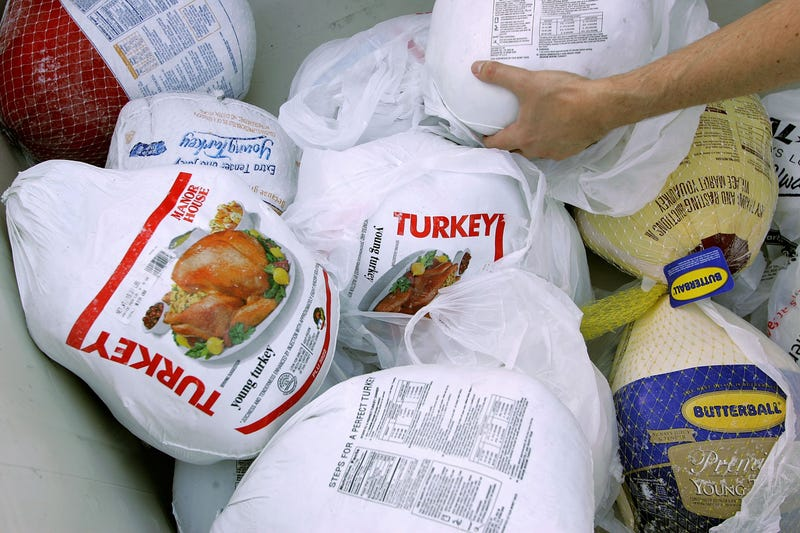 A volunteer prepares a box of turkeys to be given out during the 2006 holiday turkey distribution at the San Francisco Food Bank November 21, 2006 in San Francisco, California.
