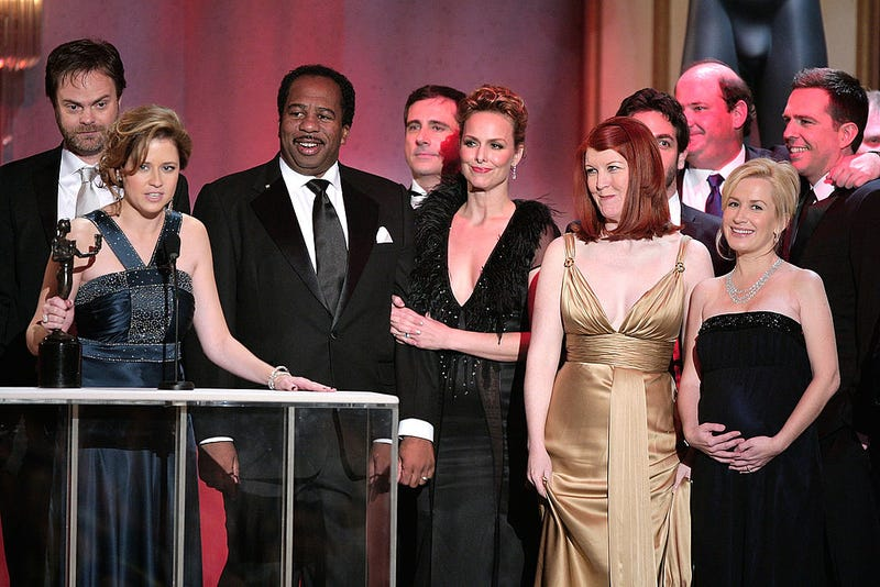 "L-R) Rainn Wilson, Jenna Fischer, Leslie David Baker, Melora Hardin, Steve Carell and Kate Flannery accept the Outstanding Performance by an Ensemble in a Comedy Series for ""The Office"" onstage during the 14th annual Screen Actors Guild awards."