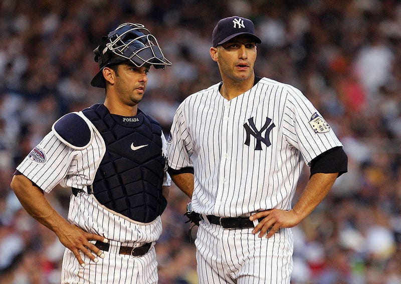 Jorge Posada and Andy Pettitte talk things over during a game.
