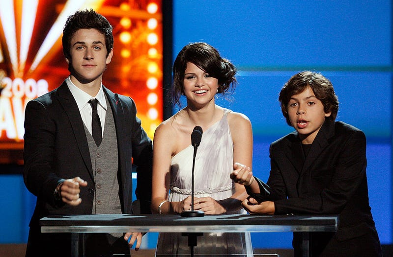 Actors David Henrie, Selena Gomez, and Jake T. Austin introduce Ab Quintanilla & The Kumbia All-Starz onstage during the 2008 ALMA Awards at the Pasadena Civic Auditorium on August 17, 2008 in Pasadena, California. (Photo by Vince Bucci