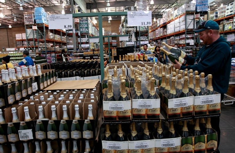 customer shops for champagne at costco
