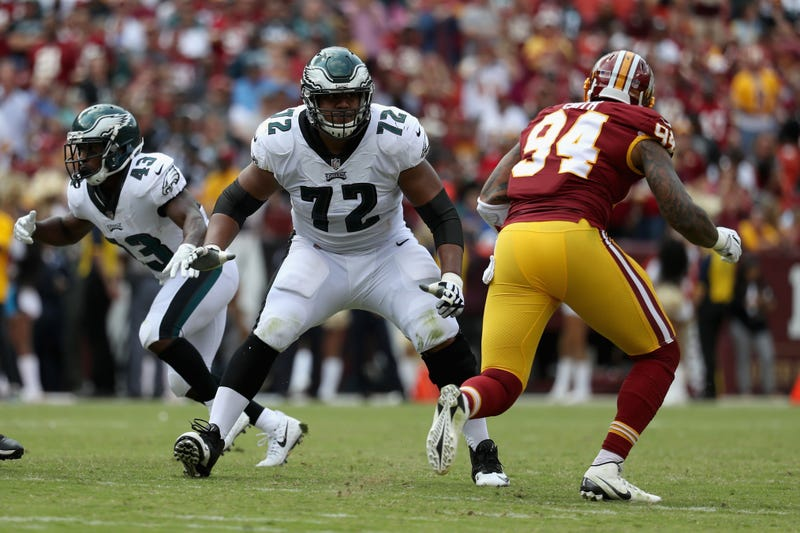 Halapoulivaati Vaitai holds his ground against Redskins linebacker Preston Smith