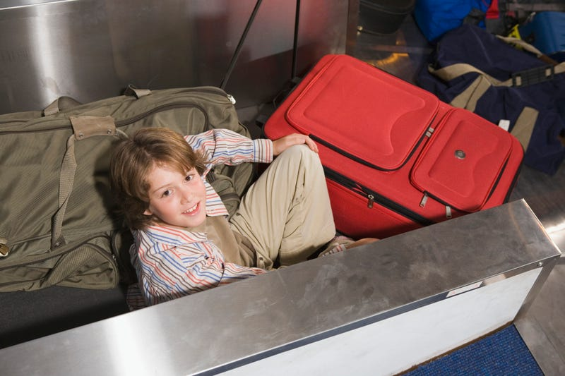 Boy on Baggage Conveyor Belt