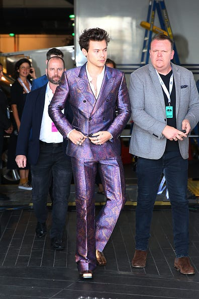 harry styles in purple suit
