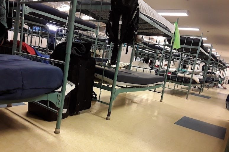 Cots in homeless shelter, bunk beds