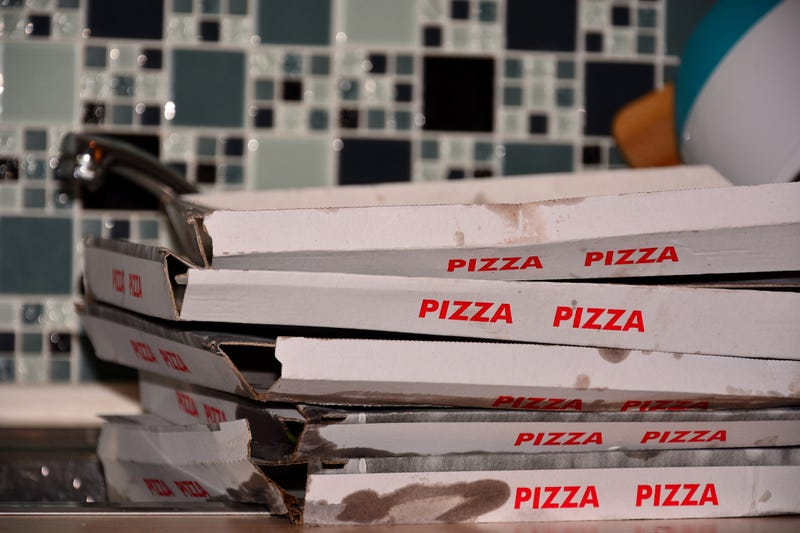 A pile of used pizza boxes