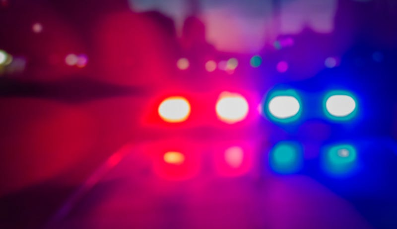 Lights of police car in night time. Night patrolling the city, lights flashing. Abstract blurry image.
