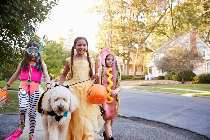 children trick or treating on street