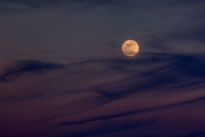 """The Moon rises over the Mojave Desert before becoming a so-called """"super blue blood moon"""" when it becomes totally eclipsed before dawn, on January 31, 2018 near Amboy, California."""