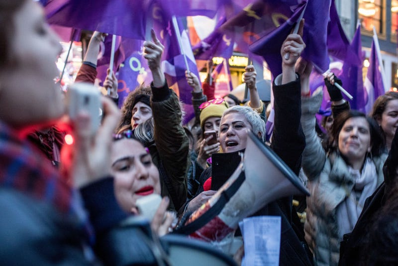 People chant slogans as they march down Istanbul's famous Istiklal street during a rally for International Women's Day 2018 in Istanbul, Turkey.