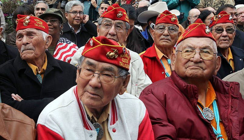 Members of the elite Navajo Code Talkers, the famed U.S. Marine unit who delivered unbreakable codes during World War II battles against the Japanese, look on before the start of the annual Veterans Day parade November 11, 2009 in New York City.