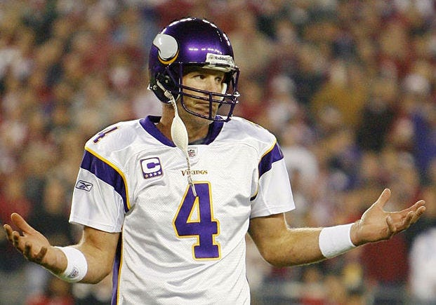 Brett Favre shrugs in reaction to a play with the Vikings.
