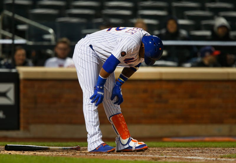 Mets outfielder Yoenis Cespedes reacts to making an out