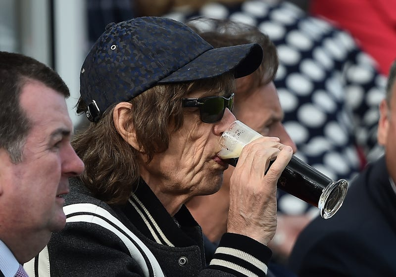 mick jagger drinking a beer