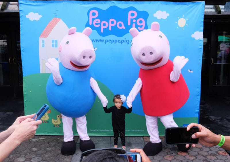 Children pose with Peppa Pig during GOOD+ Foundation's 2018 NY Bash sponsored by Hearst on May 31, 2018 in New York City