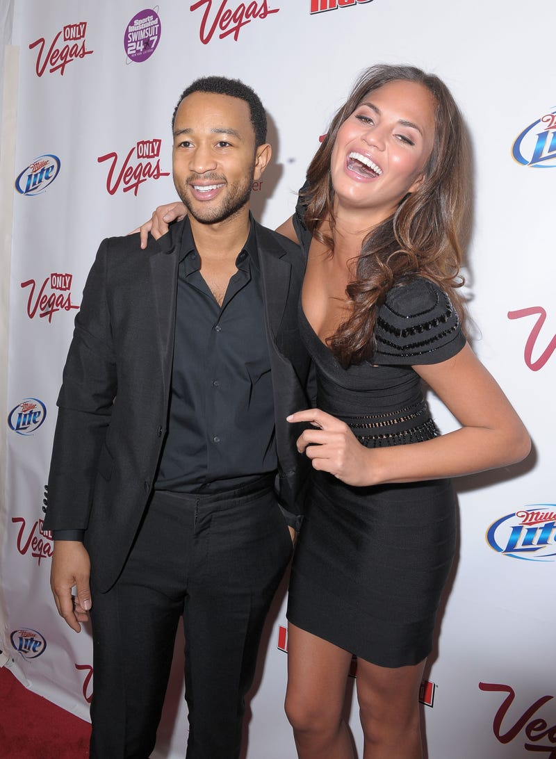 john legend and chrissy teigen on red carpet
