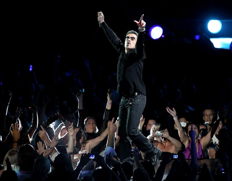 """Singer George Michael performs on stage in concert on the first night of his """"George Michael Live"""" Australian tour at Burswood Dome on February 20, 2010 in Perth, Australia."""