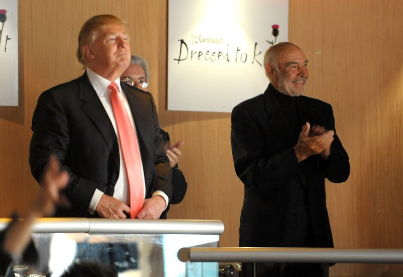 "Donald Trump (L) and Sir Sean Connery look on as models walk the runway at the 8th annual ""Dressed To Kilt"" Charity Fashion Show presented by Glenfiddich at M2 Ultra Lounge on April 5, 2010 in New York City."