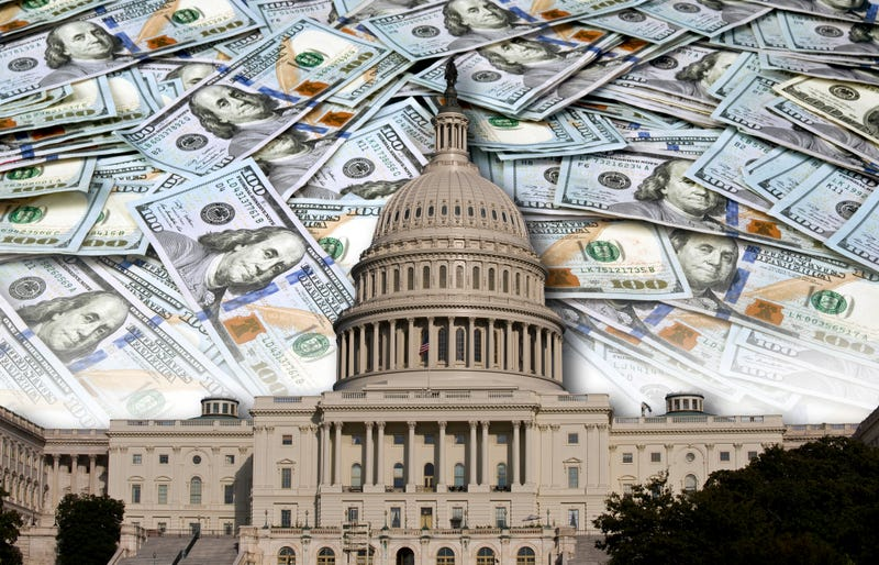 $100 bills with the US Capitol in the foreground