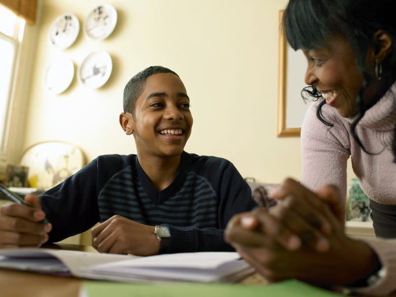A mother and son work together on his homework