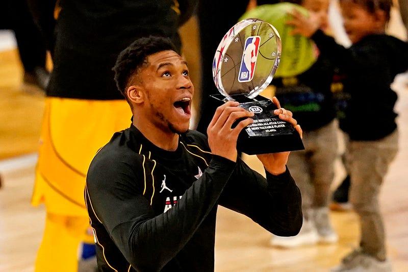 Mar 7, 2021; Atlanta, Georgia, USA; Team LeBron forward Giannis Antetokounmpo of the Milwaukee Bucks (34) reacts to being named the MVP of the 2021 NBA All-Star Game at State Farm Arena. Mandatory Credit: Dale Zanine-USA TODAY Sports
