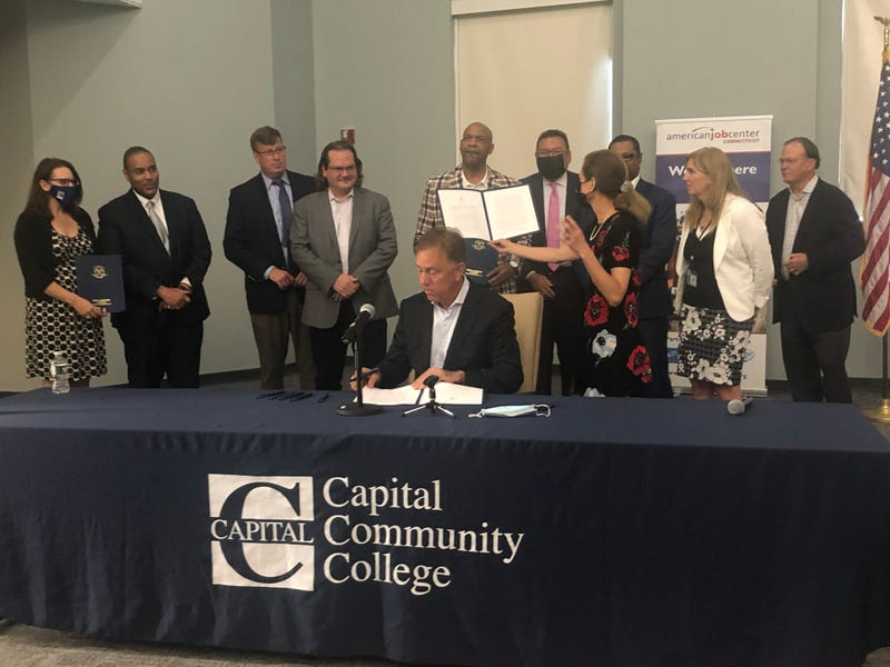 Governor Ned Lamont signs bill at Capital Community College