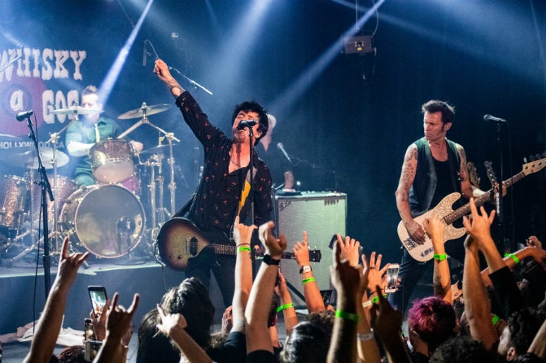 "Tré Cool, Billie Joe Armstrong and Mike Dirnt of Green Day perform during the ""Hella Mega Tour"" announcement show at Whisky a Go Go"
