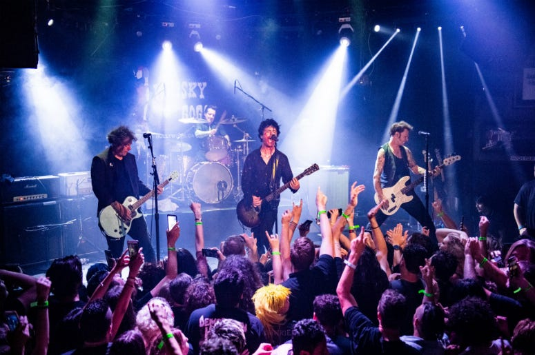 "Green Day perform during the ""Hella Mega Tour"" announcement show at Whisky a Go Go"