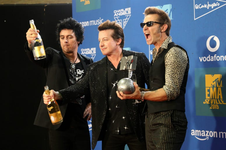 Billie Joe Armstrong, Tre Cool and Mike Dirnt from Green Day with the Best Rock Award in the winners room during the MTV EMAs 2019