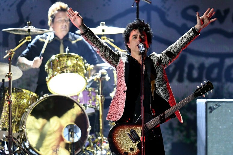 Green Day performs on stage