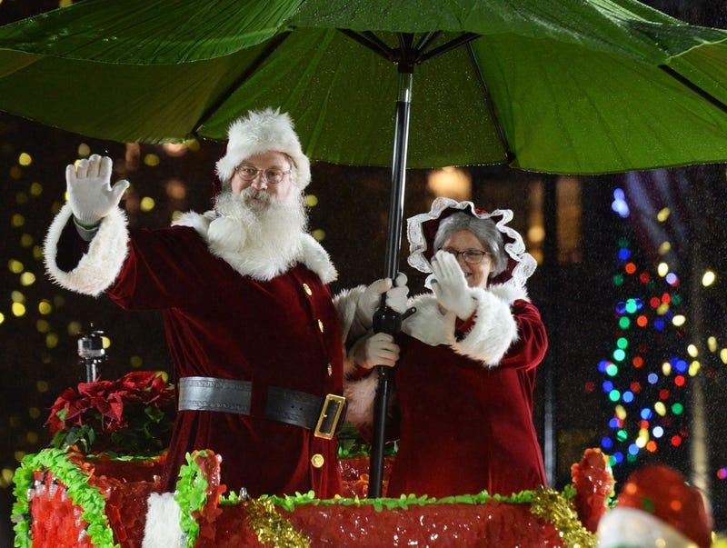 Santa and Mrs. Claus at the Greenville Poinsettia Christmas Parade 2018 in downtown Greenville.