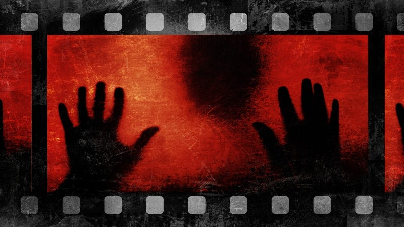 Scary film head hands shadow Getty Images