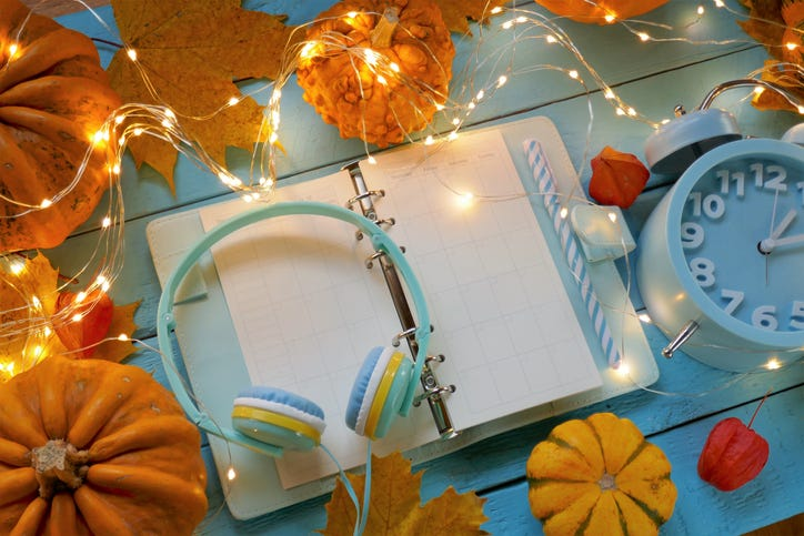 headphones on a planner with lights and pumpkins