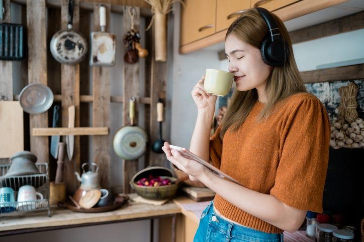 girl wearing headphones in the kitchen