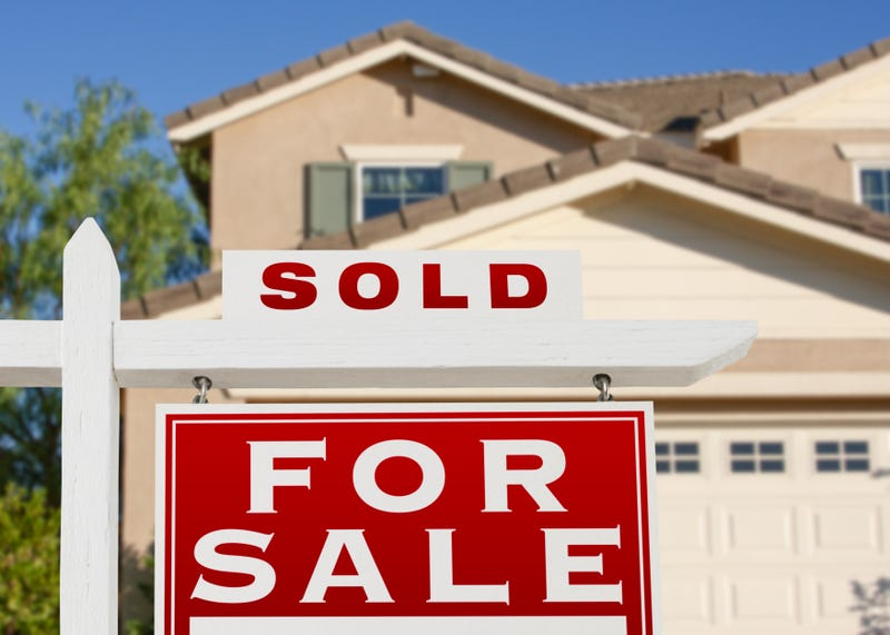 "A ""sold"" sign signifying an agreement to buy a home"