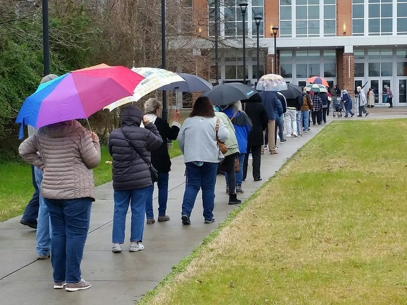 People wait in line to get vaccinated at Virginia State University.