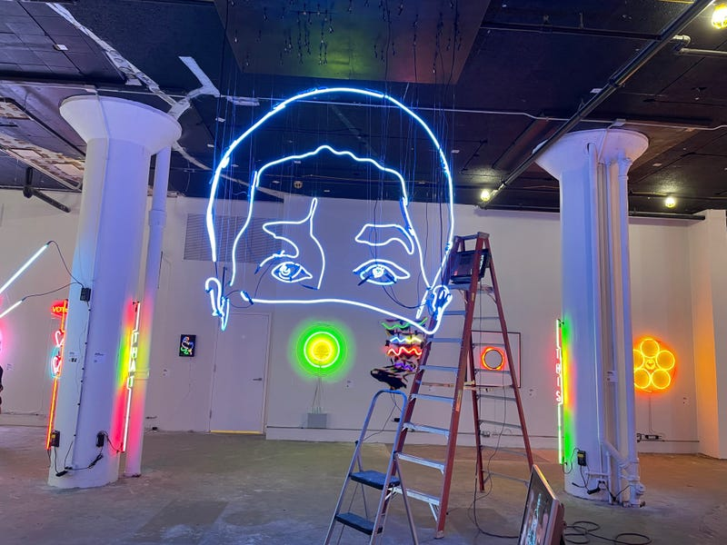 A massive 14-foot-tall neon sculpture by artist John Bannon that changes based on your angle of view at the Neon and Light Museum