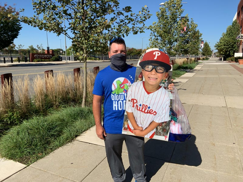 Pat Adare of West Deptford, N.J., holds a cutout of his 7-year-old son, Chase.