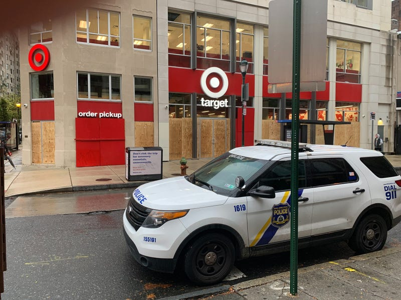 Philadelphia police are stationed at intersections throughout Center City, and many businesses are closed or boarded up on Friday.