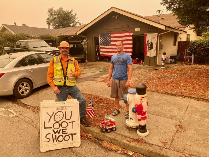 Neighbors John Allen and Al Smith protect Santa Rosa's Rincon Valley neighborhood after the Glass Fire moved through.