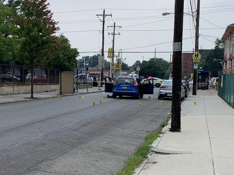 At least 17 pieces of evidence marked at the scene of a triple shooting where two teenagers were killed.