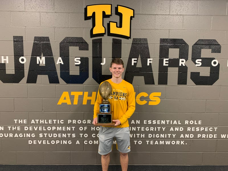 Thomas Jefferson quarterback Jake Pugh poses with his award as KDKA Radio Super 7 4A Player of the Year inside the Jaguars athletic facility.